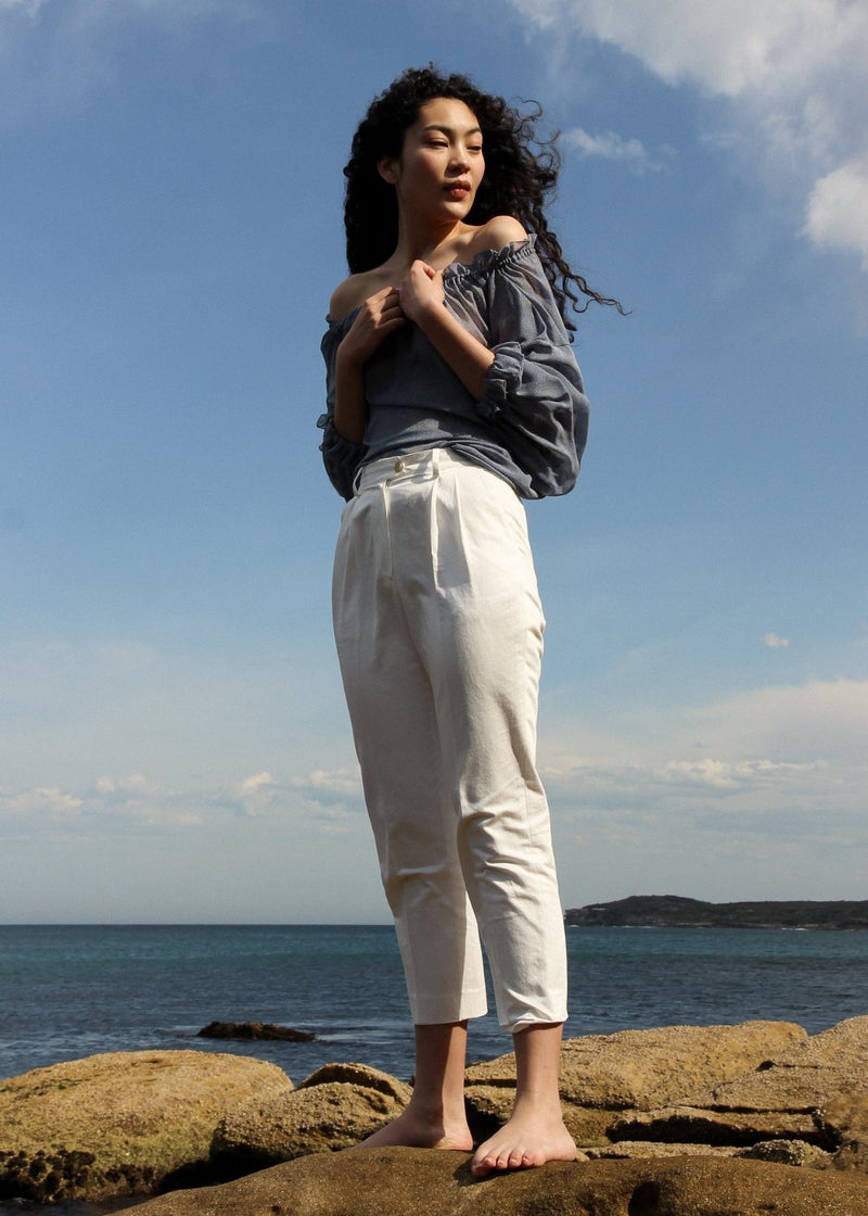 Marlo wears the Mireille Blouse in Cornflower Poppyseed with Elaine Pleat Trousers, both from Laundromat