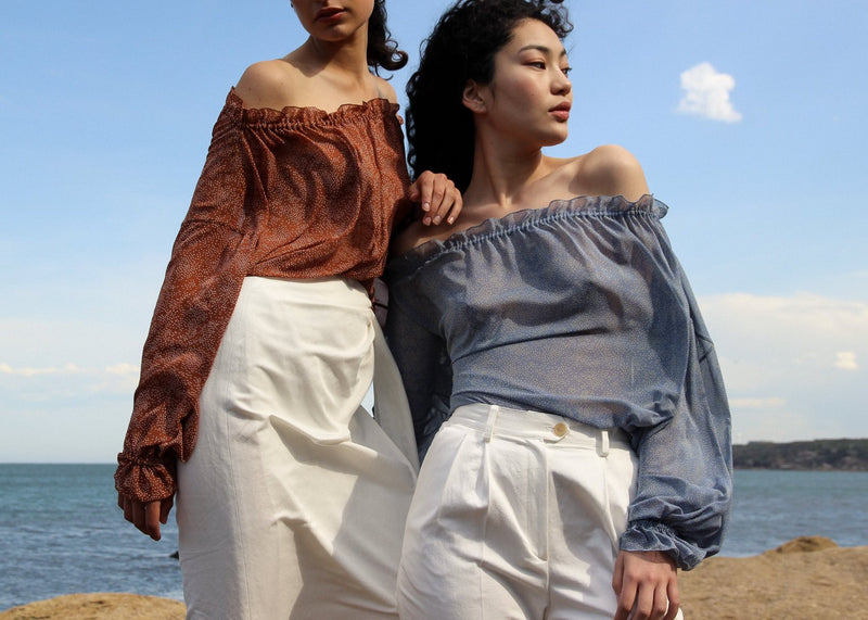 India and Marlo wearing the Mireille Blouse, both from Laundromat
