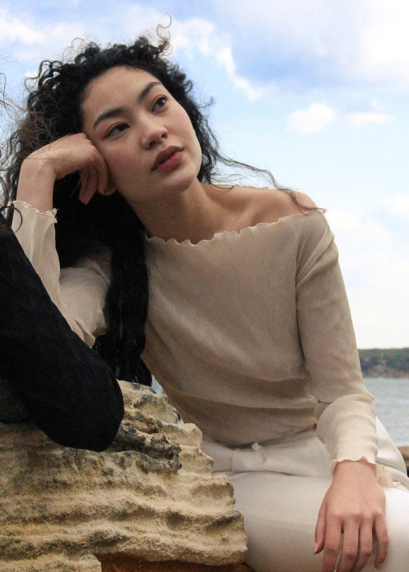 Marlo daydreaming in the boatneck Oriana Wave Plissé Top in Oyster Shell from Laundromat