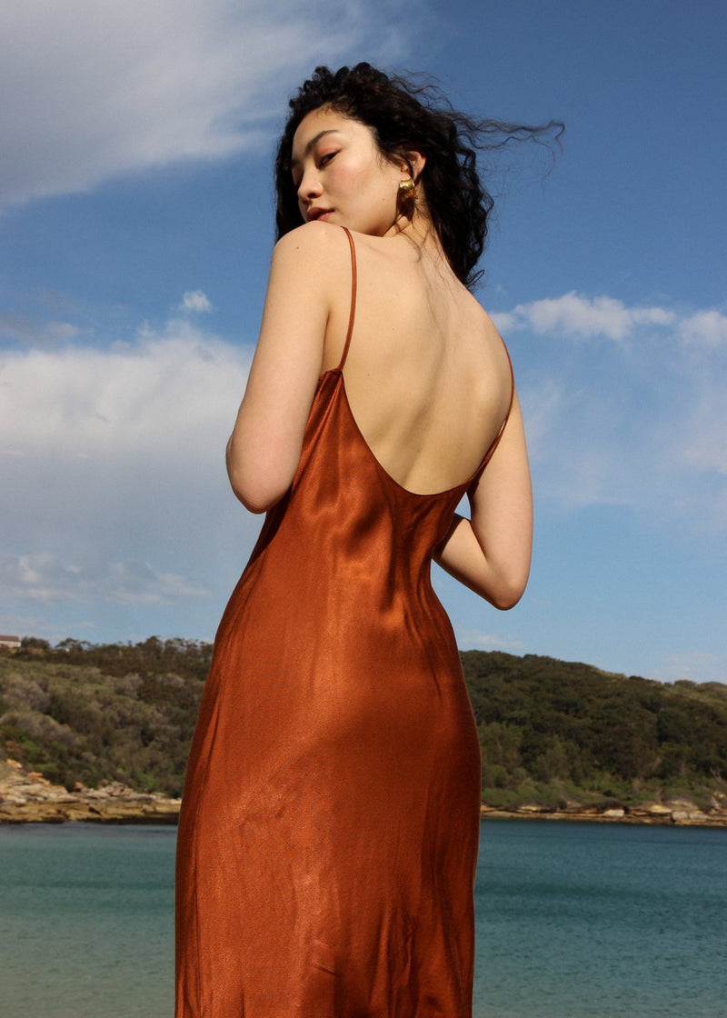Marlo wears the Salma Slip Dress in Sienna with low scoop back detail from Laundromat