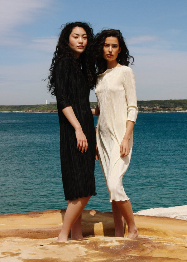 Marlo and India wearing the Severina Plissé Dress, both from Laundromat
