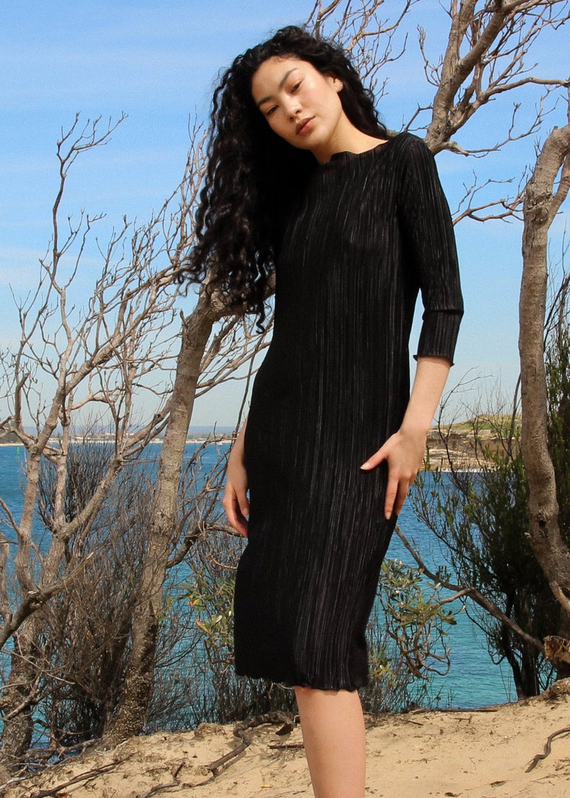Marlo wears the Severina Plissé Dress in Liquorice from Laundromat