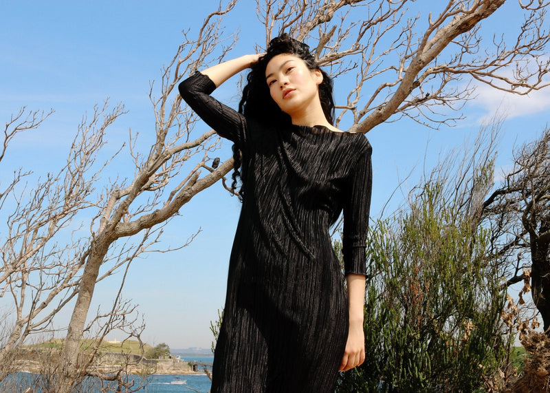 Marlo wears the boatneck Severina Plissé Dress in Liquorice from Laundromat