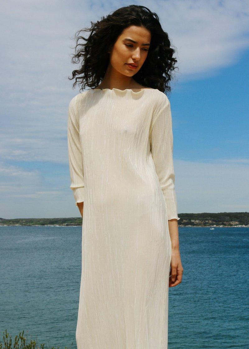 India wearing the boatneck Severina Plissé Dress in Pearl from Laundromat
