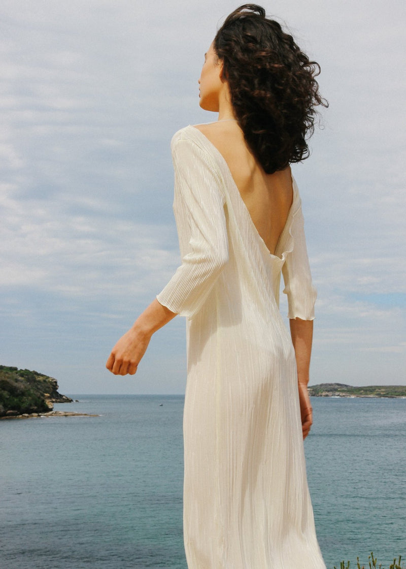 Back detail of India in the Severina Plissé Dress in Pearl by Laundromat