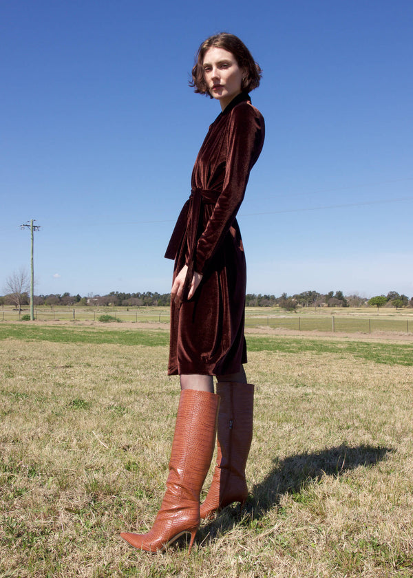 Olivia wears the Mona Velvet Wrap Dress in Ganache by Laundromat