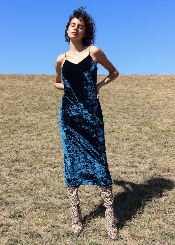 Maya wearing the Ophelia Velvet Slip Dress in Persian Blue from Laundromat