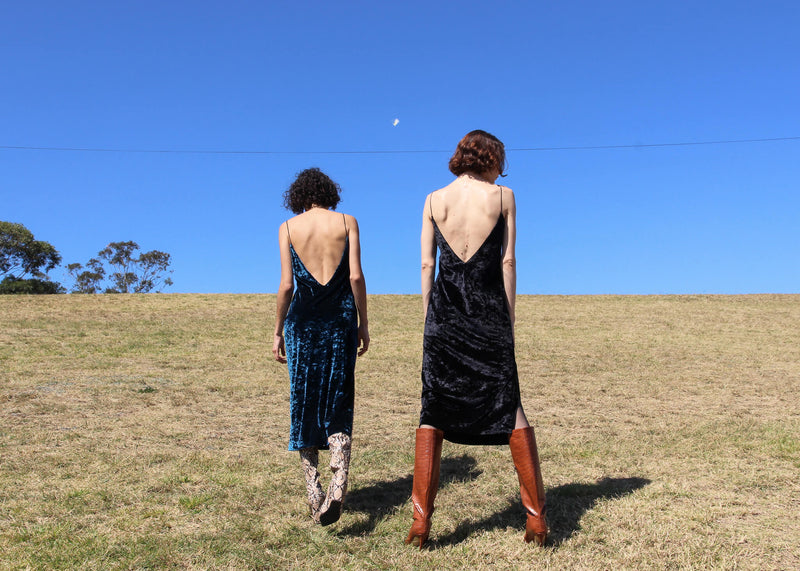 Maya and Olivia wear the Ophelia Velvet Slip Dress, both from Laundromat