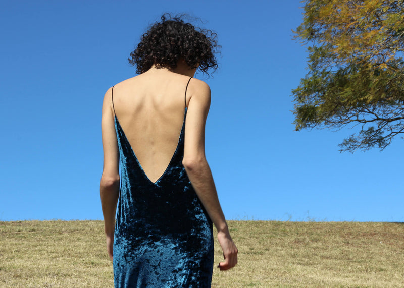 Back detail of the Ophelia Velvet Slip Dress worn by Maya
