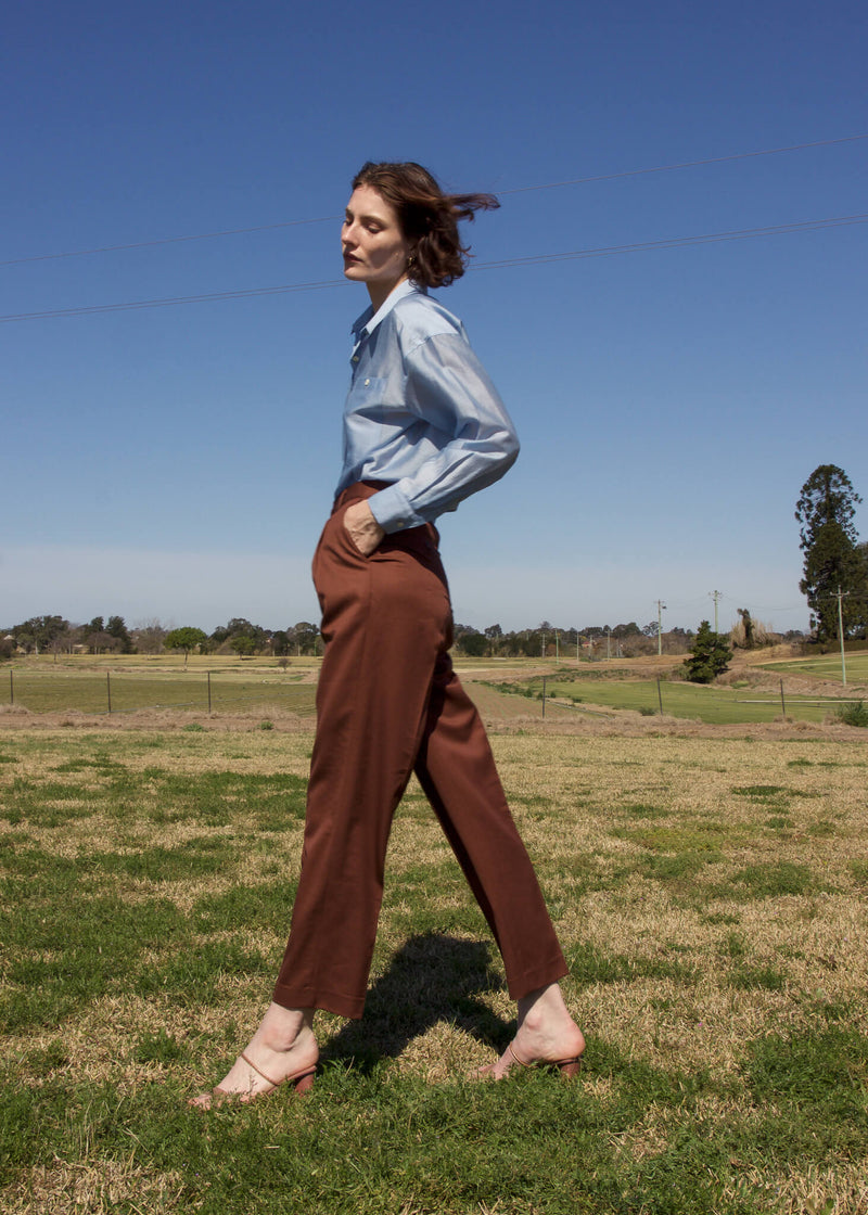 Olivia wears the Paige Tencel Pocket Shirt and wool pants from Laundromat