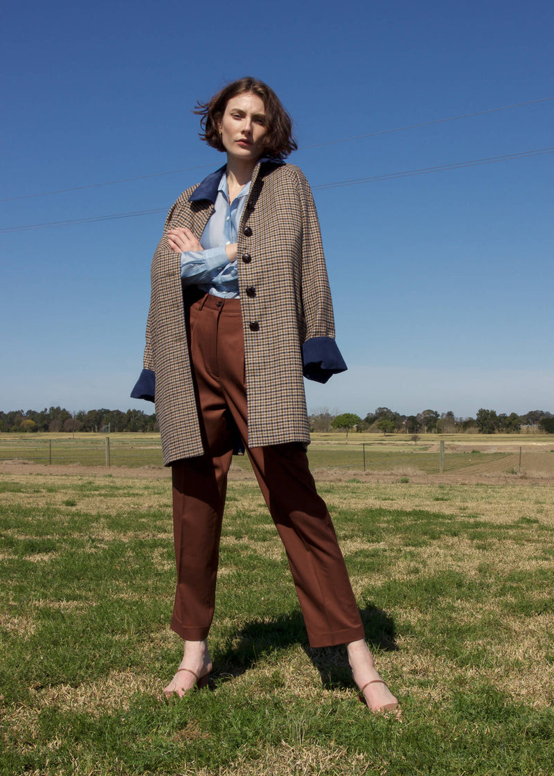 Olivia wears the Paige Tencel Pocket Shirt and wool coat, both from Laundromat