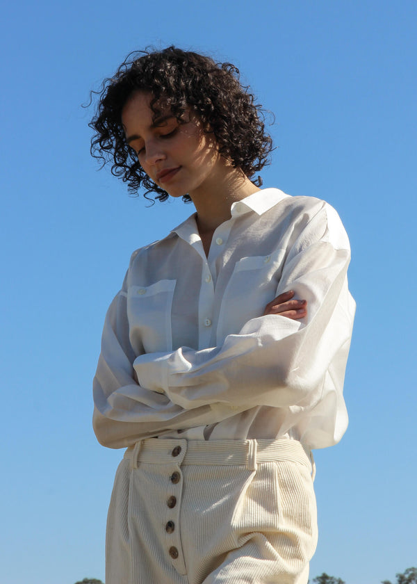 Maya wears the Paige Tencel Pocket Shirt in Porcelain from Laundromat