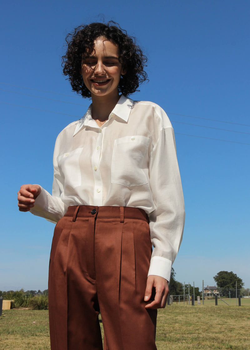 Maya wears the Paige Tencel Pocket Shirt and wool pants, both from Laundromat