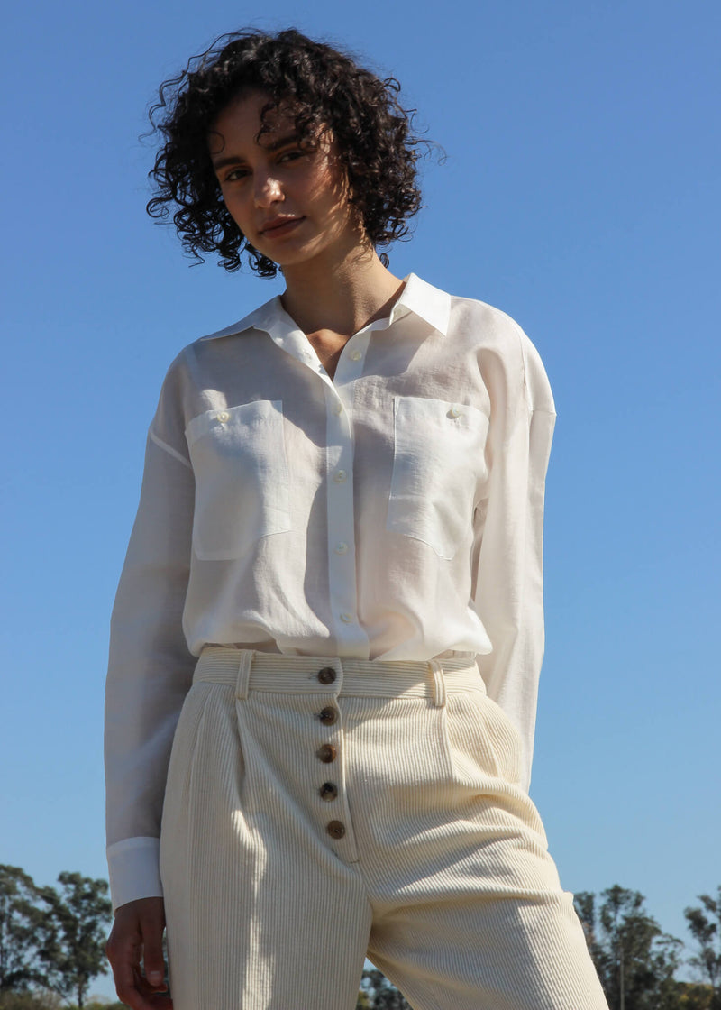 Maya wears the Paige Tencel Pocket Shirt and corduroy pants, both from Laundromat