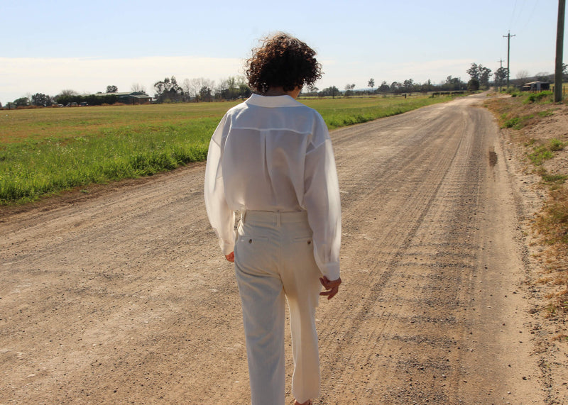 Back of the Paige Tencel Pocket Shirt and corduroy pants worn by Maya