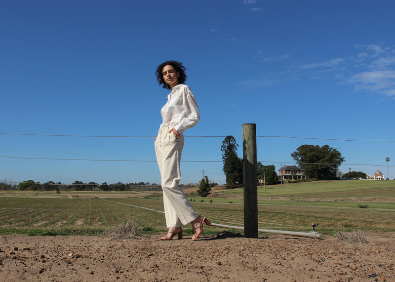 Maya wears the Rumi Corduroy Button-up Trousers from Laundromat