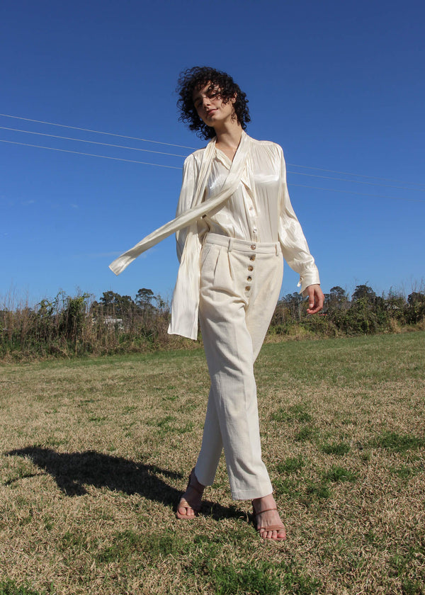 Maya wears the Rumi Corduroy Button-up Trousers in Macadamia