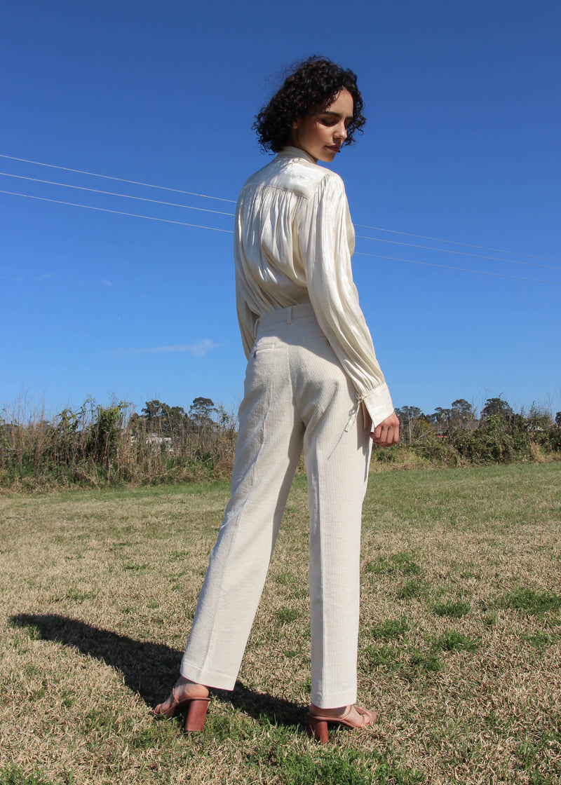 Back of the Rumi Corduroy Button-up Trousers worn by Maya