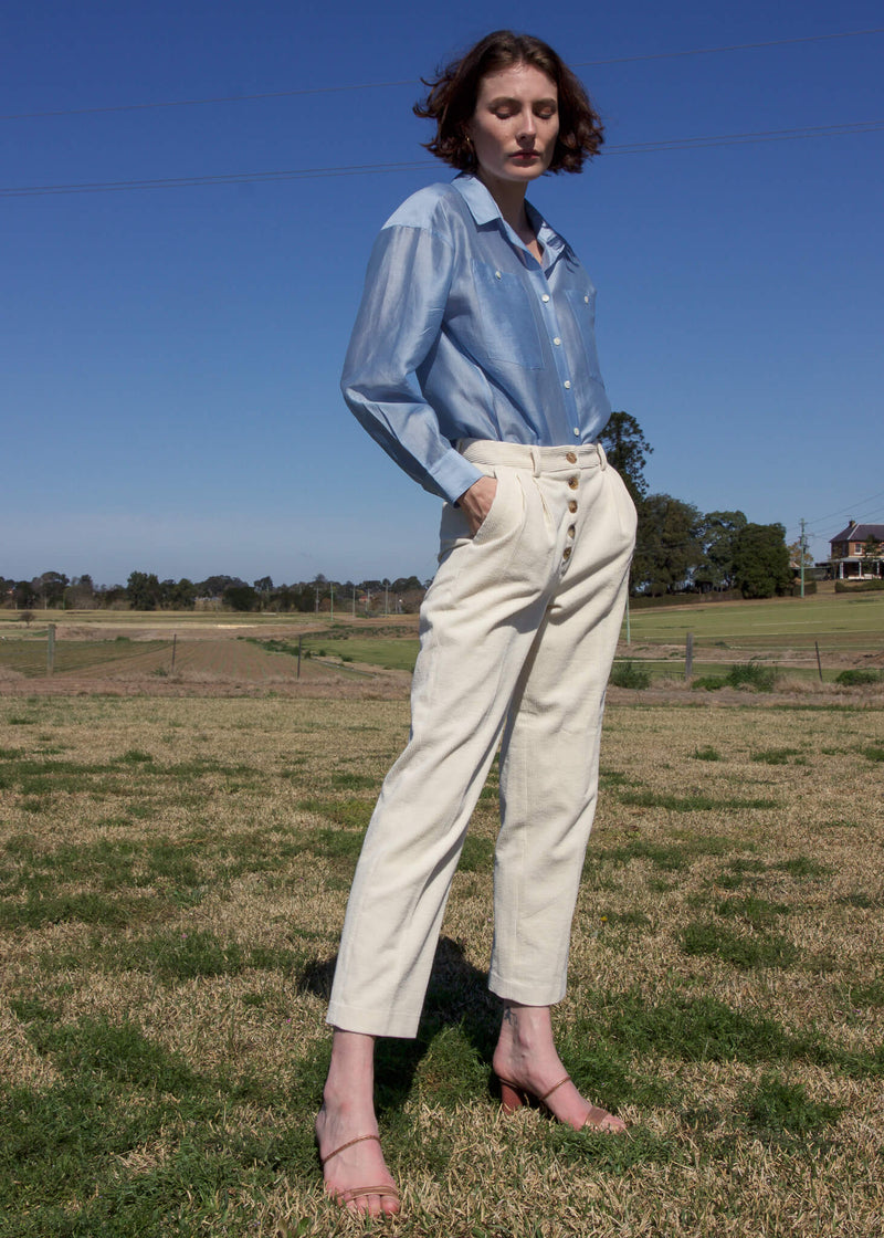 Olivia wearing the Rumi Corduroy Button-up Trousers from Laundromat