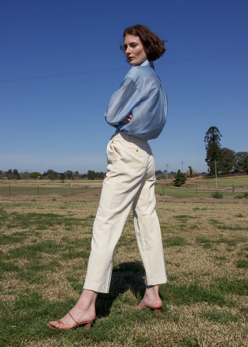 Olivia wearing the Rumi Corduroy Button-up Trousers in Macadamia