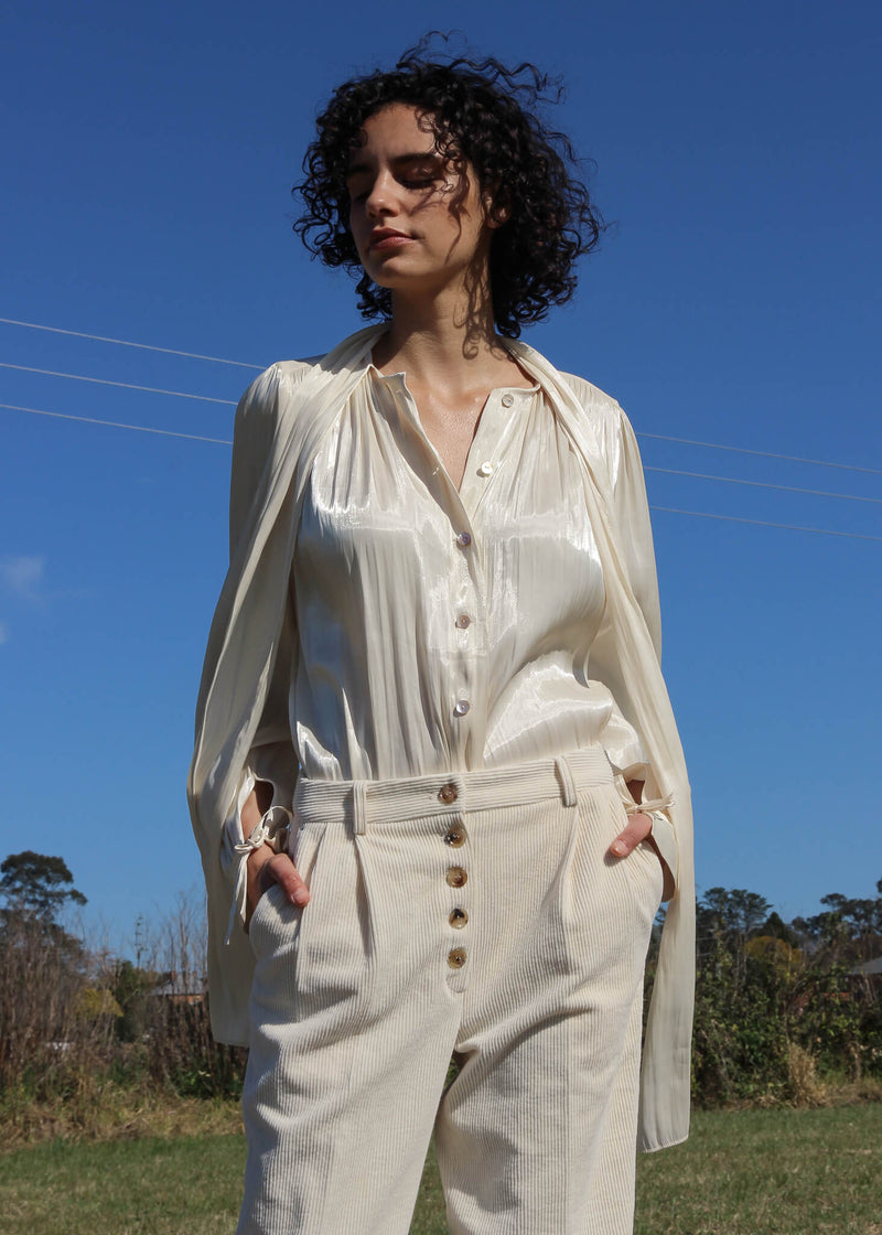 Detail of the Rumi Corduroy Button-up Trousers worn by Maya