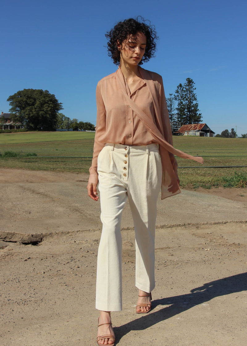 Maya wearing the Rumi Corduroy Button-up Trousers in Macadamia from Laundromat