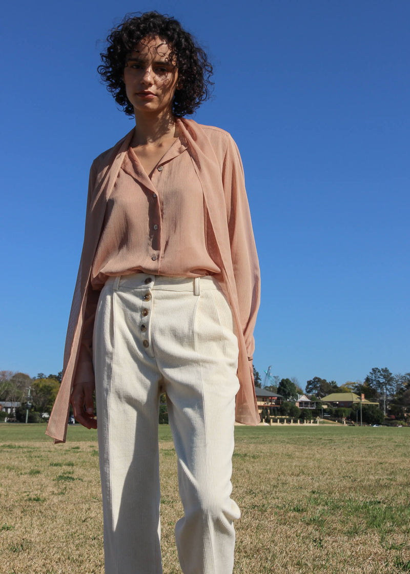 Maya wearing the Rumi Corduroy Button-up Trousers and blouse, both from Laundromat