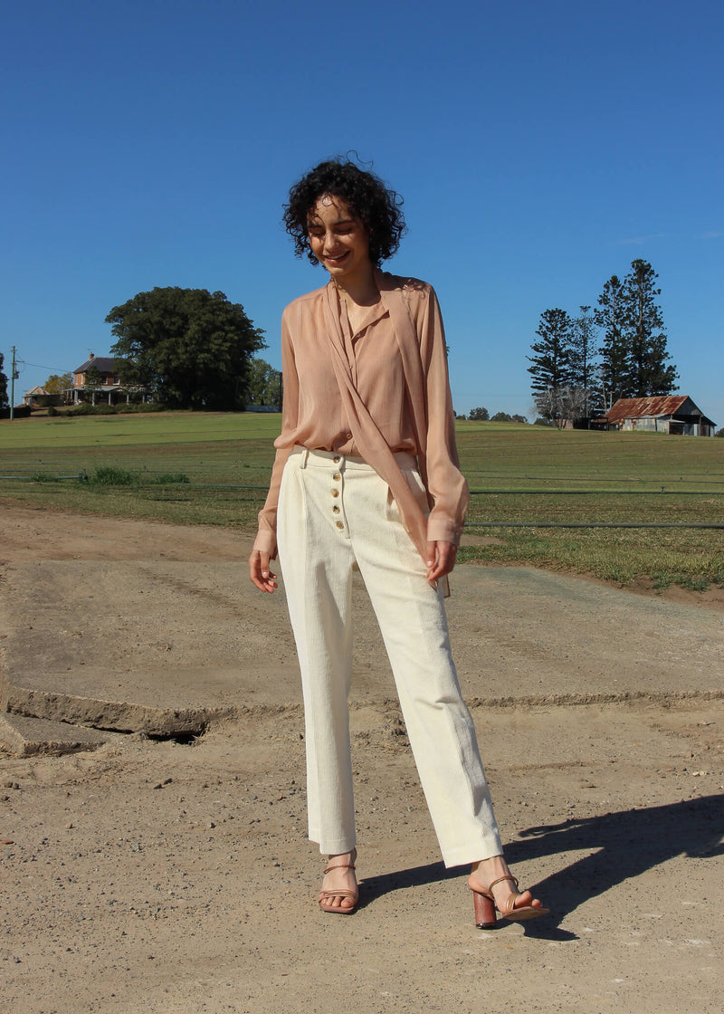 Maya wearing the Rumi Corduroy Button-up Trousers