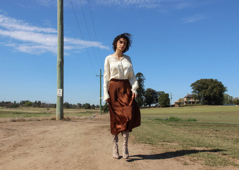 Maya wearing the Yasmin Bias Slip Skirt and white blouse