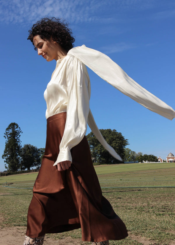 Maya wears the Yasmin Bias Slip Skirt in Chocolate from Laundromat