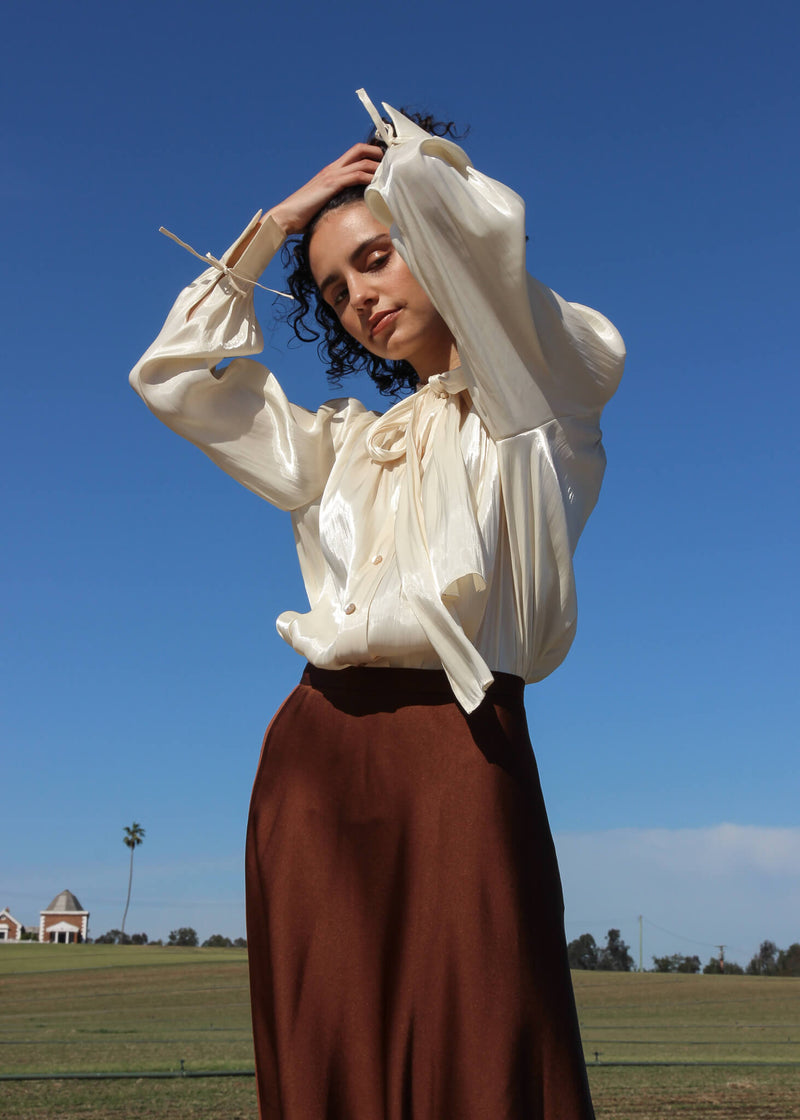 Maya wears the Yasmin Bias Slip Skirt and blouse, both from Laundromat