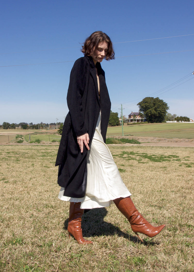 Olivia in the Yasmin Bias Slip Skirt and cashmere coat, both from Laundromat
