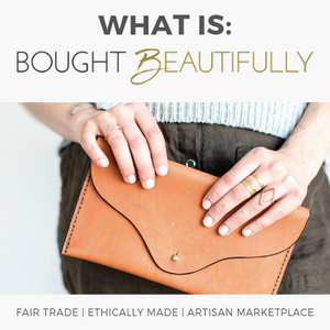 What is Bought Beautifully? Woman holds fair trade accessories