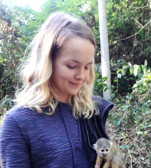 volunteer and rescued squirrel monkey