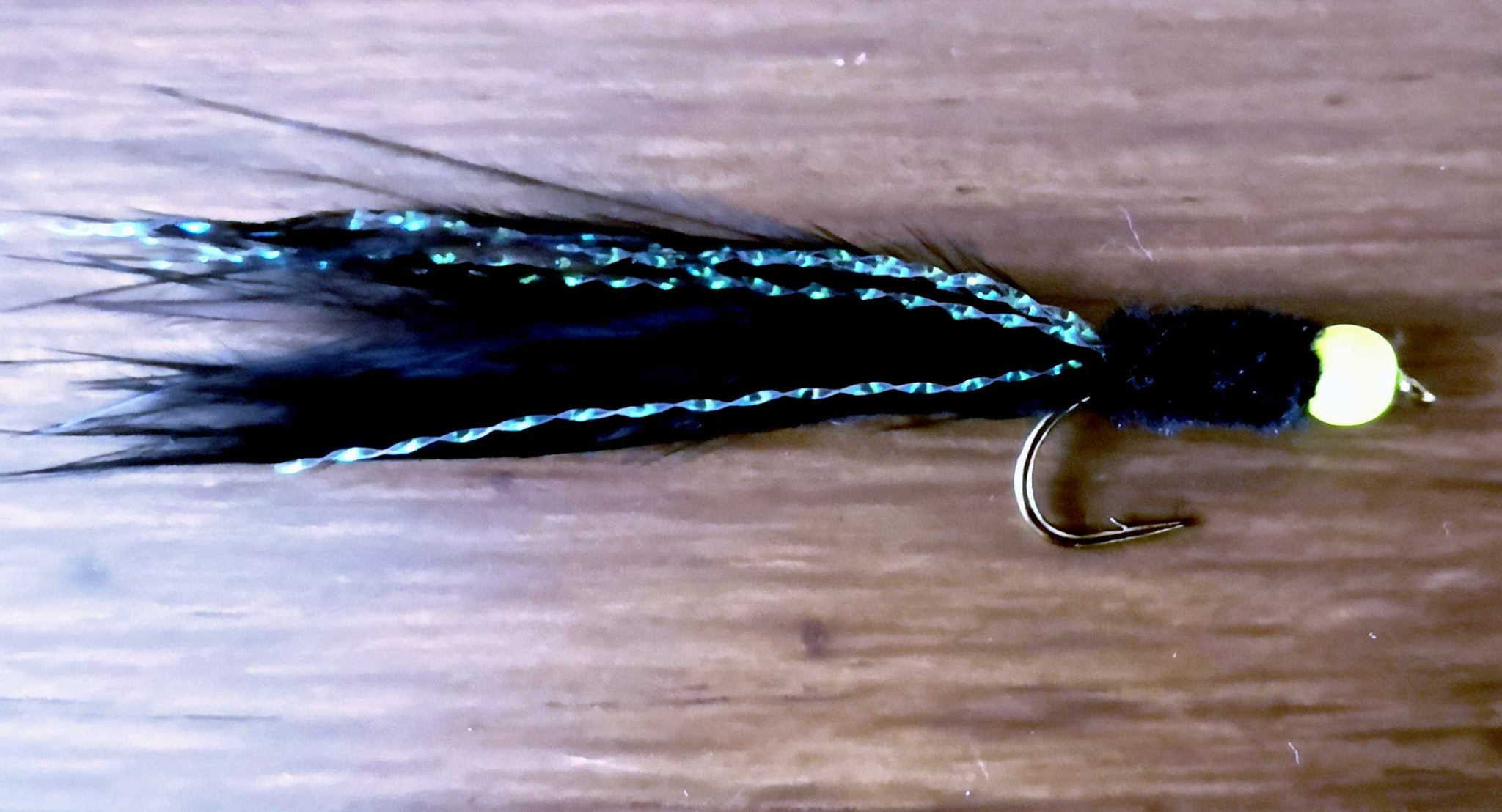 Black Chenille Tadpole With Fluo Yellow Bead Head