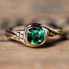 Emerald Pirouette Ring in 14k Yellow Gold