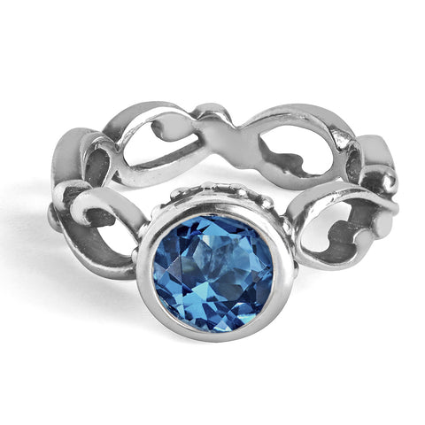 Bezel set round london blue topaz set into sterling silver filigree infinity ring