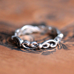 Sterling silver swirling wave band ring