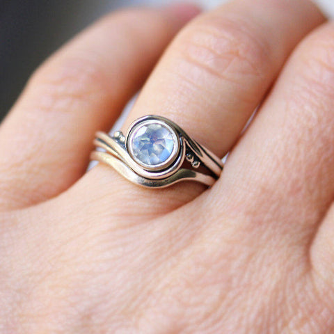 The rainbow moonstone engagement ring in Pirouette from Metalicious being worn