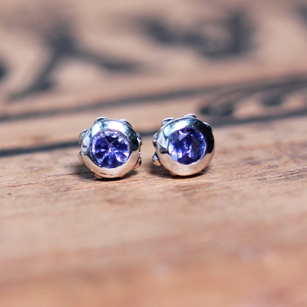 Sterling silver studs with beading and purple sapphires.