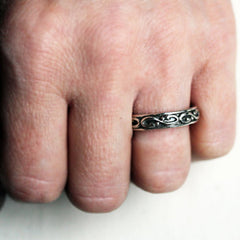 oxidized silver mens wedding band shown on the hand