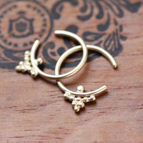 Yellow gold open hoop earrings with beaded cluster detailing.