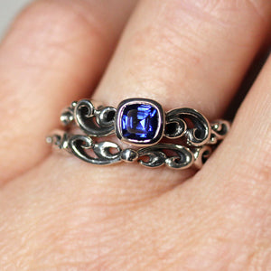 Water Dream wedding ring set made of sterling silver and sapphire from Metalicious being worn