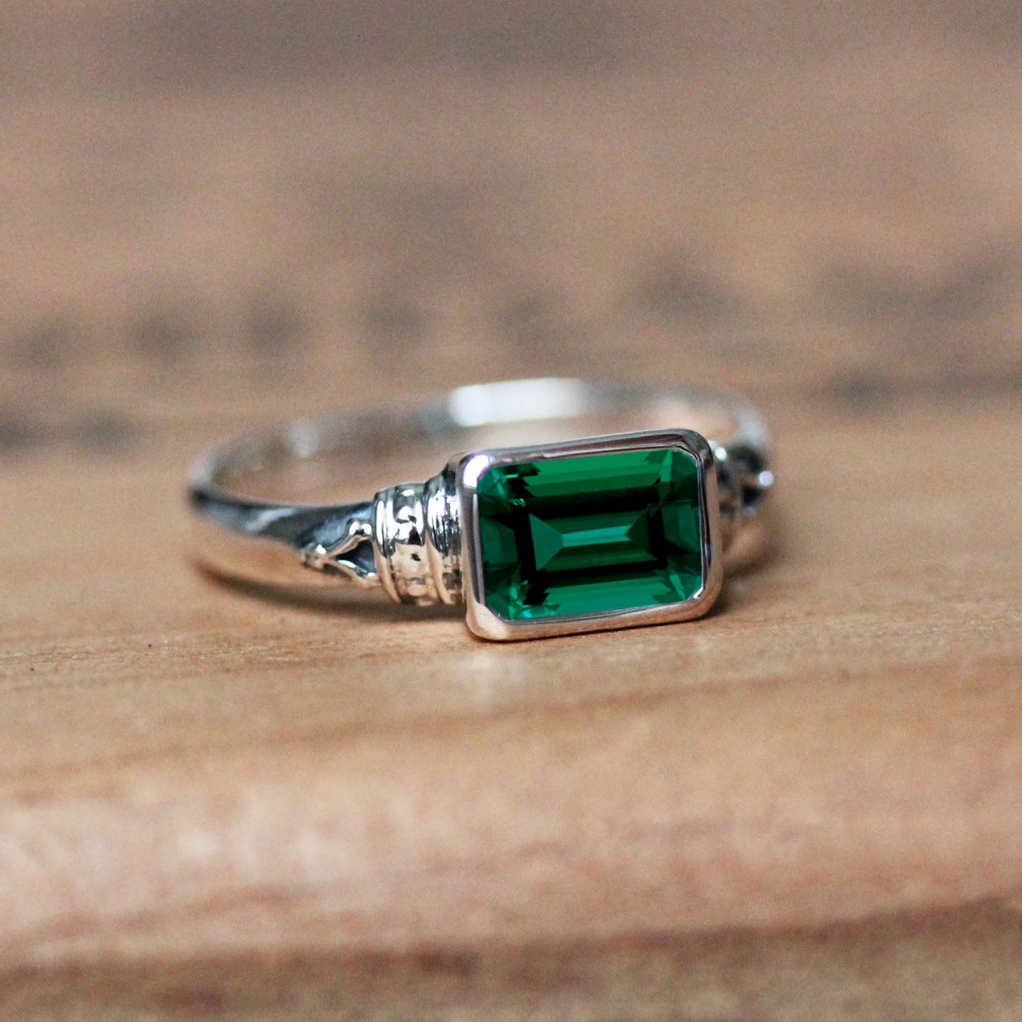 created emerald ring in sterling silver setting