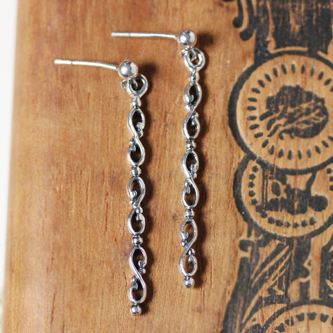 Wrought Infinity Long Drop Earrings