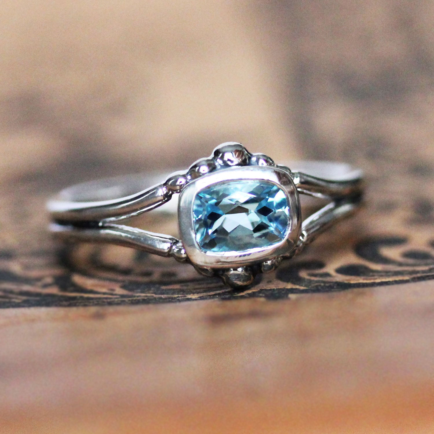 Sterling silver ring with beading and aquamarine gemstone.