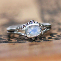 Sterling silver ring with beading and rainbow moonstone.