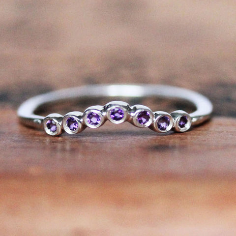 Sterling silver shadow band with seven small amethyst gemstones.