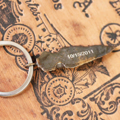 Bronze arrowhead keychain with dates etched on the back by Metalicious