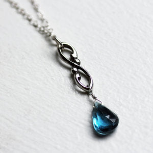 handmade-ethical-Wrought-Swirl-Infinity-London-Blue-Topaz-necklace-02